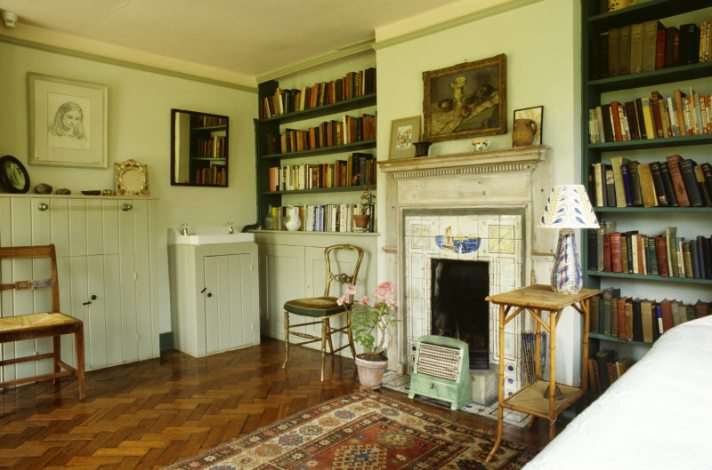 The interior of Virginia Woolf's bedroom at Monks House looking towards the fireplace.
